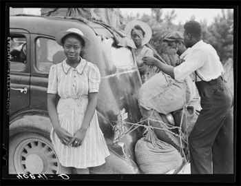 Group of Florida migrants on their way to Cranberry, New Jersey, to pick potatoews near Shawboro, North Carolina (1940)